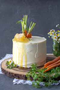 Carrot cake on wood with honey comb