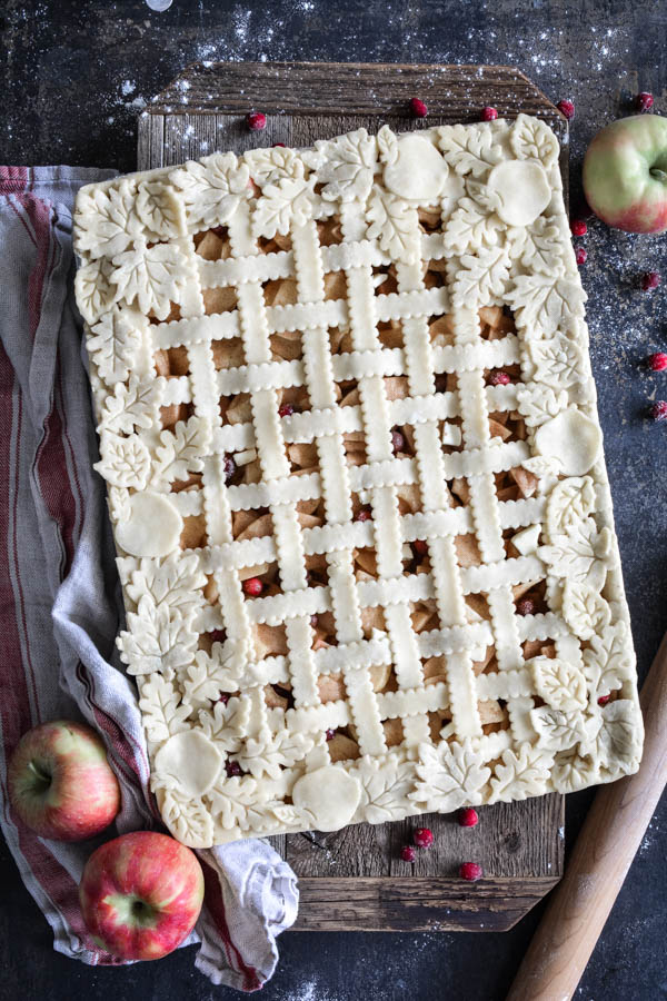 overhead shot of lattice apple cranberry slab pie
