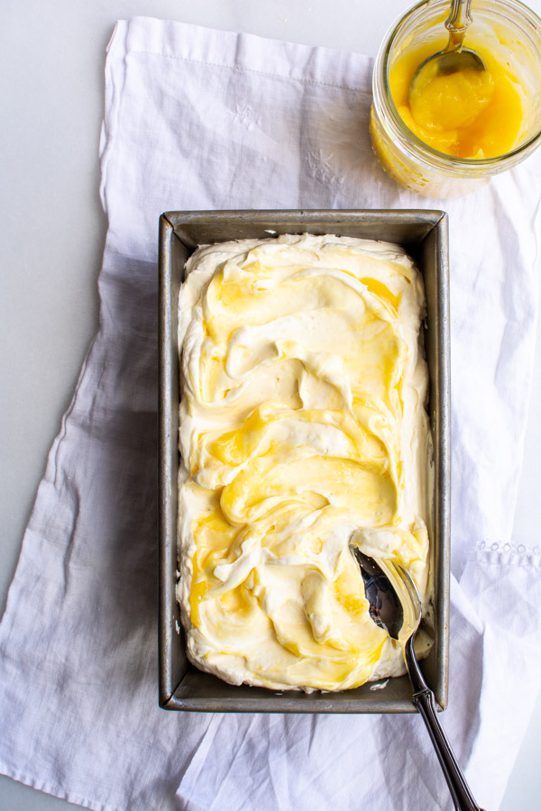 Lemon curd swirled into whipped no churn lemon curd ice cream