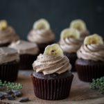 Chocolate chunk banana cupcakes with nutella icing banana chip on top