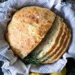 overhead shot of sliced No-knead Lemon Rosemary Gruyere Bread