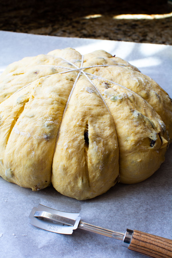No-knead pumpkin harvest bread dough shaped with string to form a pumpkin