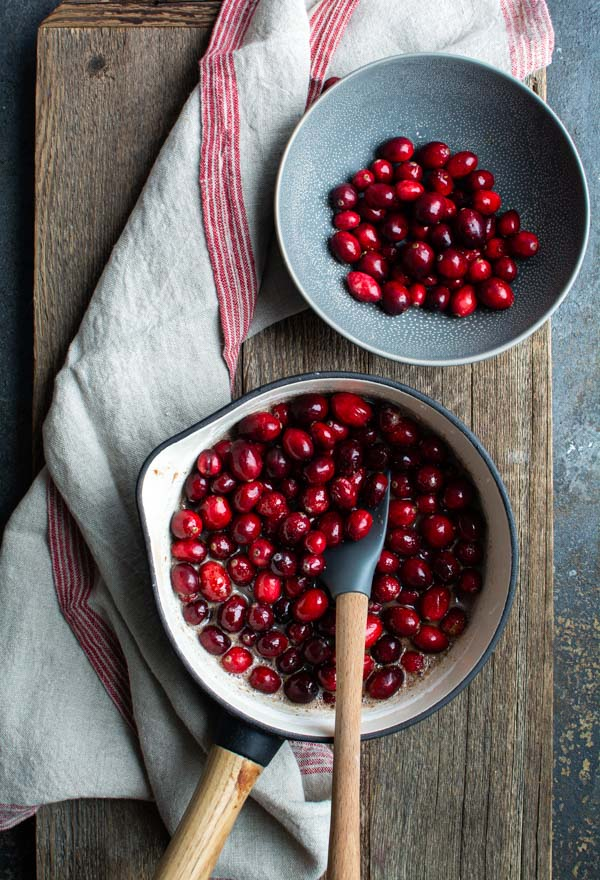 saucepan and bowl filled with cranberries