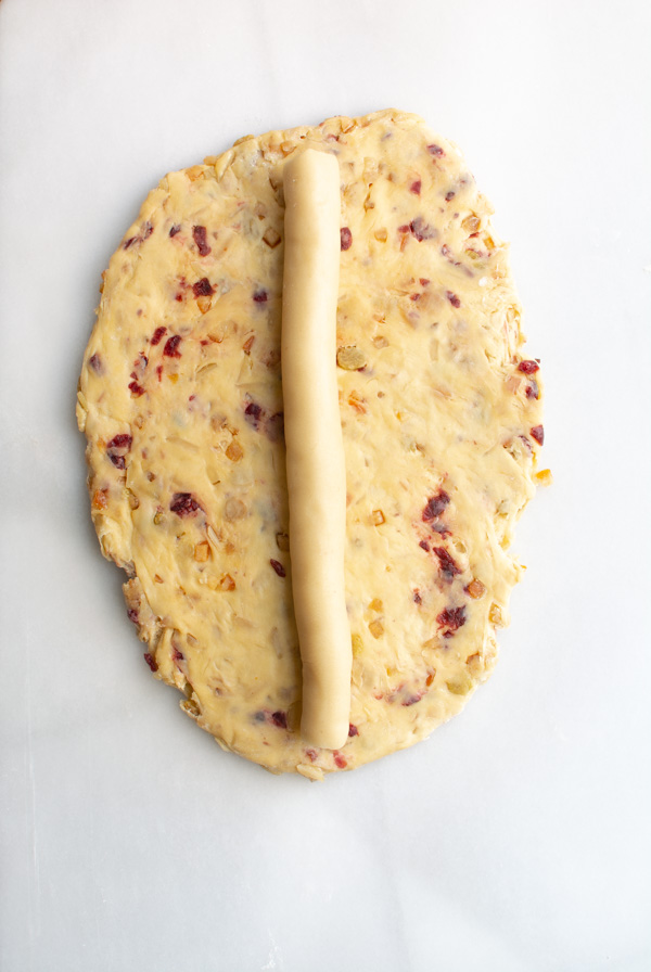 Rolled out Stollen dough with log of marzipan in the center