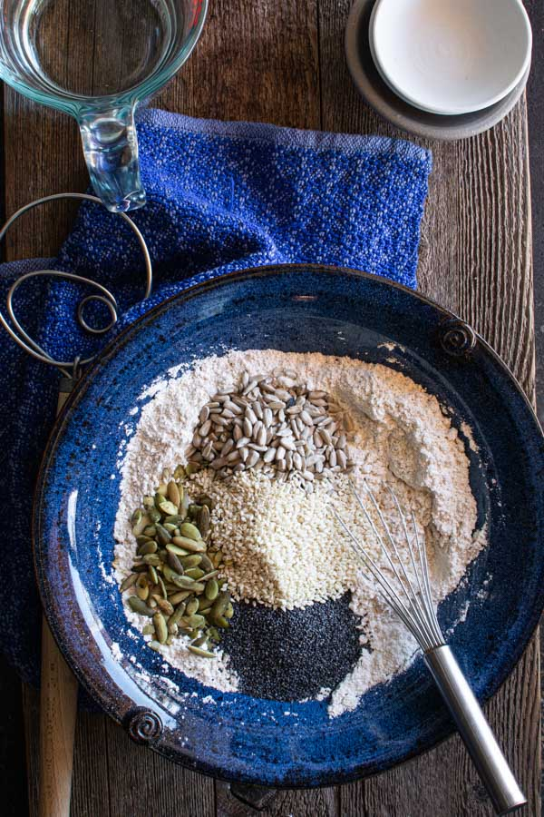 Large bowl with flour and , pumpkin seeds, sesame seeds, sunflower seeds, and poppy seeds