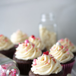 Chocolate cupcakes iced with fluffiest white chocolate icing with valentine sprinkles