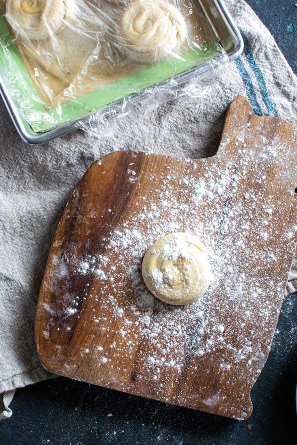 Floured ball of paratha on cutting board