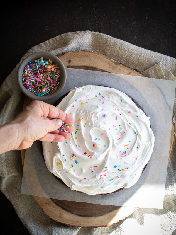 Boiled icing on chocolate cake with sprinkles on top