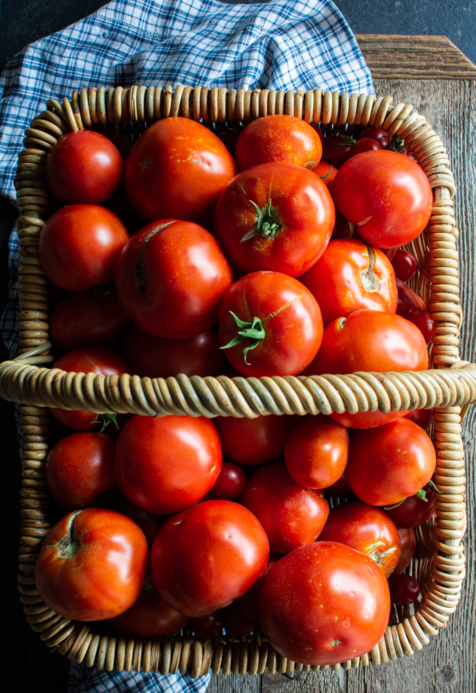 Large basket filled with red tomatoes