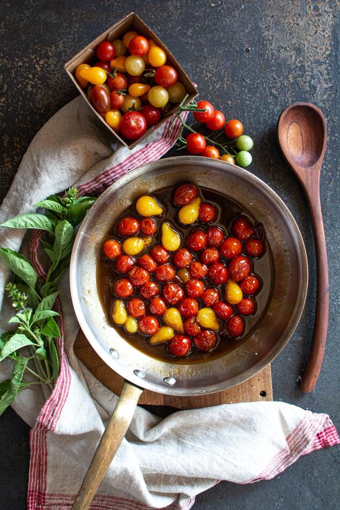 Cherry tomatoes simmering in balsamic vinegar and honey