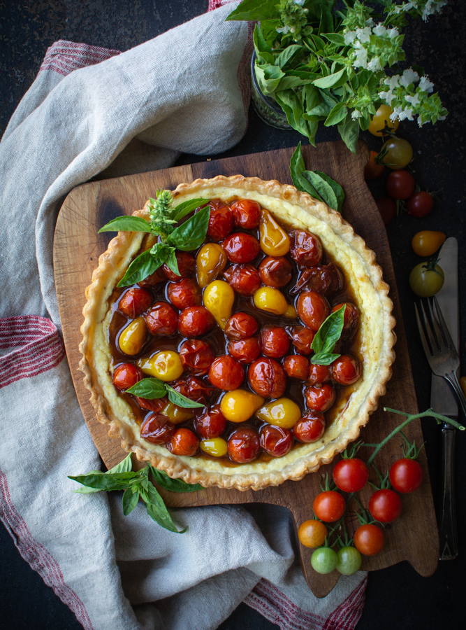 Baked ricotta tart topped with jammy cherry tomatoes