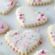 assortment of sprinkles on heart shape sugar cookies