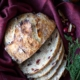 overhead shot of sliced cranberry orange pecan bread on a burgundy cloth