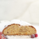 Baked stollen cut in half showing ribbon of marzipan