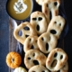 Ghost shaped fougasse on a black platter and wood background