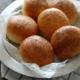 5 brioche buns on a silver platter